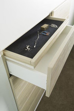 Drawers include fabric cover for jewellery