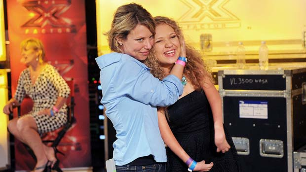 Rion Paige is hugged by her mom after she got four yeses from our judges.