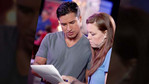 Mario Lopez goes over the script backstage.