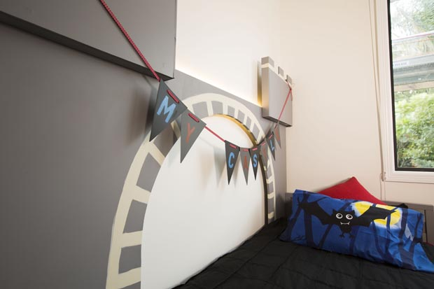 A bat pillow adds to the haunted castle theme