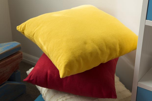 Cushions in the rooms colours can be used on the bed or the floor