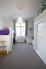 A dash of lilac is used throughout this room