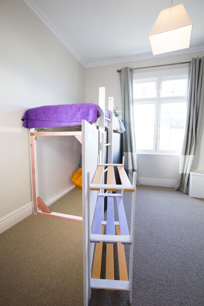 The door doubles as a ladder to the bed