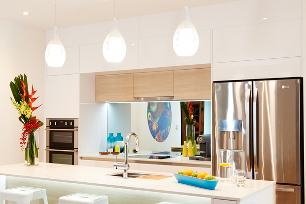 The splashback mirror helps make the kitchen feel more spacious