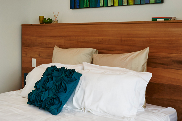 The Blue pillow brings out the blue highlights in the room