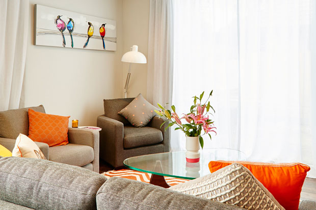 The colourful cushions go beautifully with the grey sofa.