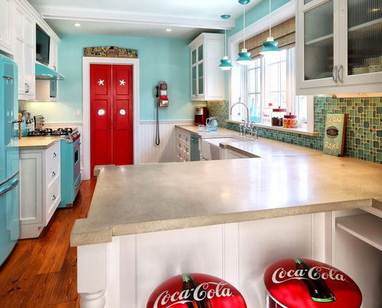 Reflecting the kitchen colours of the 60s - how cute are the Coca Cola seats?