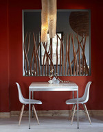 The dark scarlet walls combined with the wood/reed makes us think of an African sunset...what do you think?