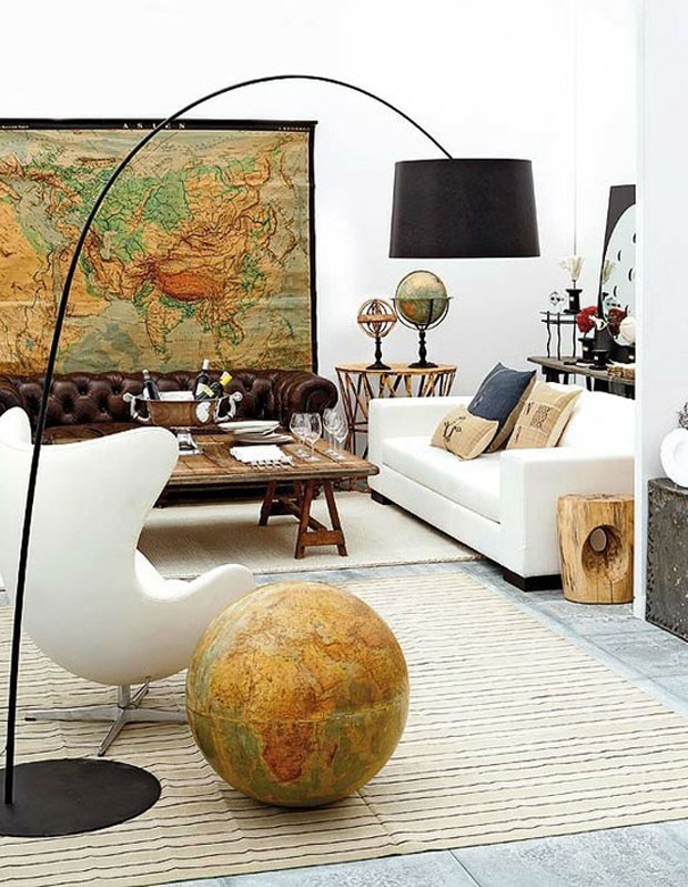 Antique maps and globes give the room a nomadic look