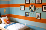 Tip 5: For a new look, paint a feature wall with bright, bold colours then add some matching pillows!