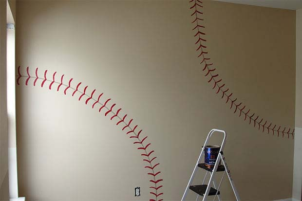 Paint stitches on the wall to feel like you're living in your favourite sports ball!