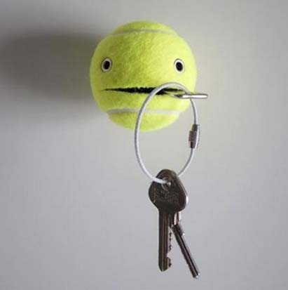 Slice open an old tennis ball, attach some googly eyes and prepare to always know where your keys are