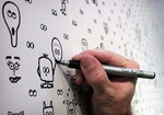 We don't usually encourage scribbling on the walls - but what about a mural you can work on together?