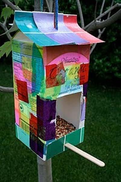 Old juice cartons and icecream sticks make a cute little birdhouse
