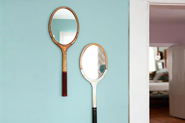 Tennis raquets used as mirrors.